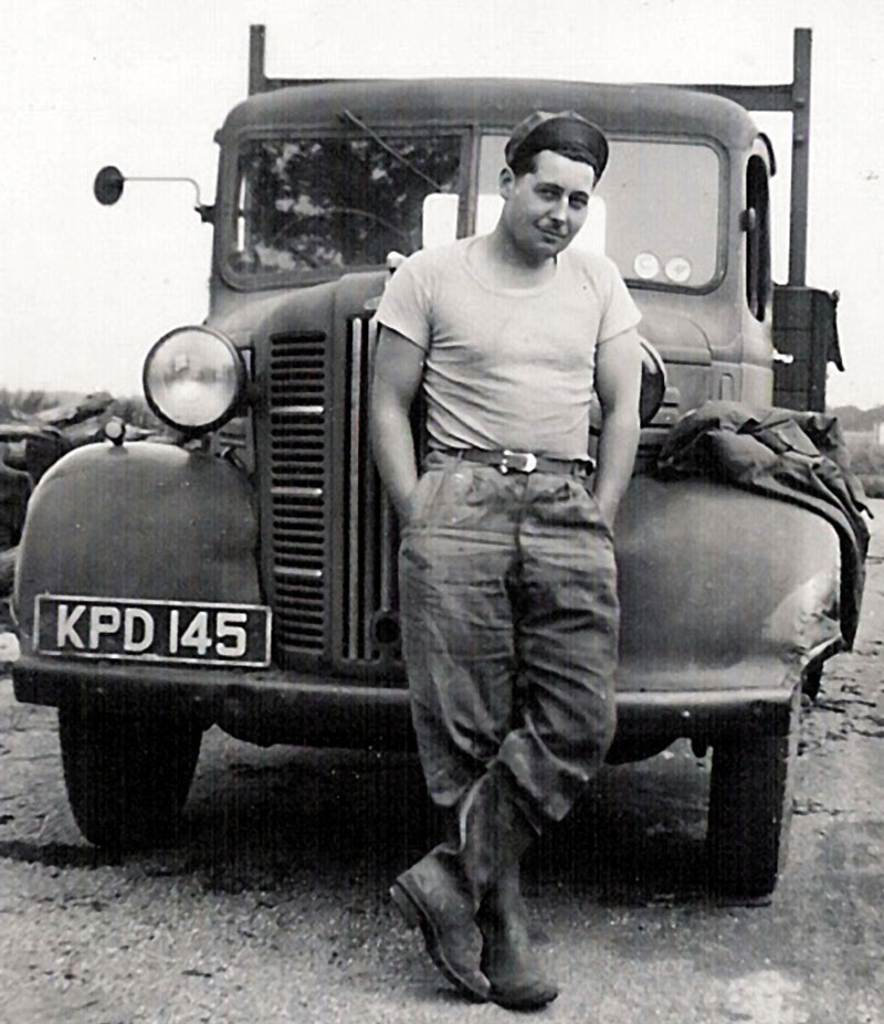 vintage black and white photo of man and lorry taken around 1949